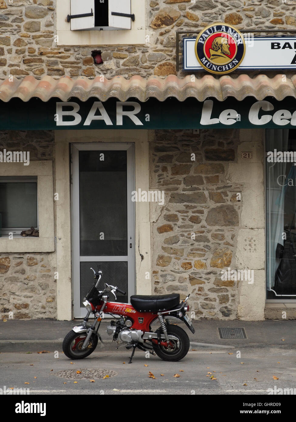 cult Honda 50cc minibike parked in front of a cafe in Conilhac, Languedoc Roussillon, southern France - Stock Image