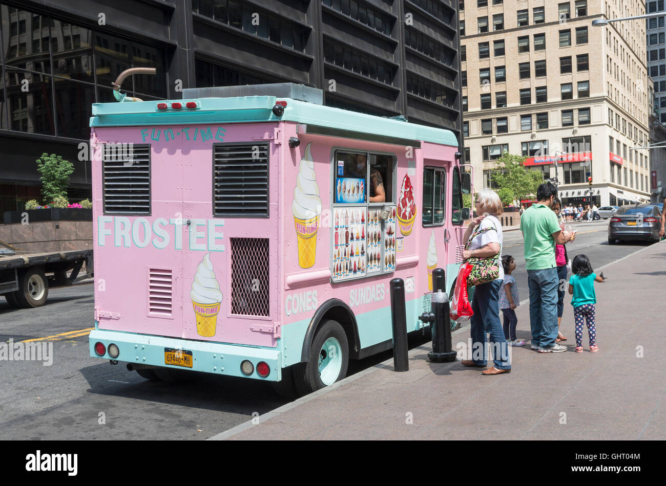 Woman and family buying ice creams from an ice cream van during a heatwave in downtown New York - Stock Image