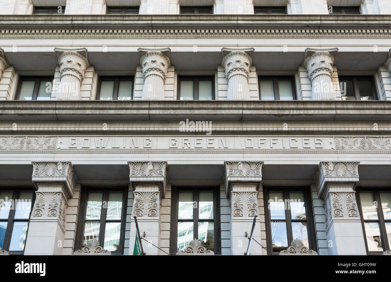 Close up of architectural detail of Bowling Green Offices building, a landmark, in the financial district of New - Stock Image