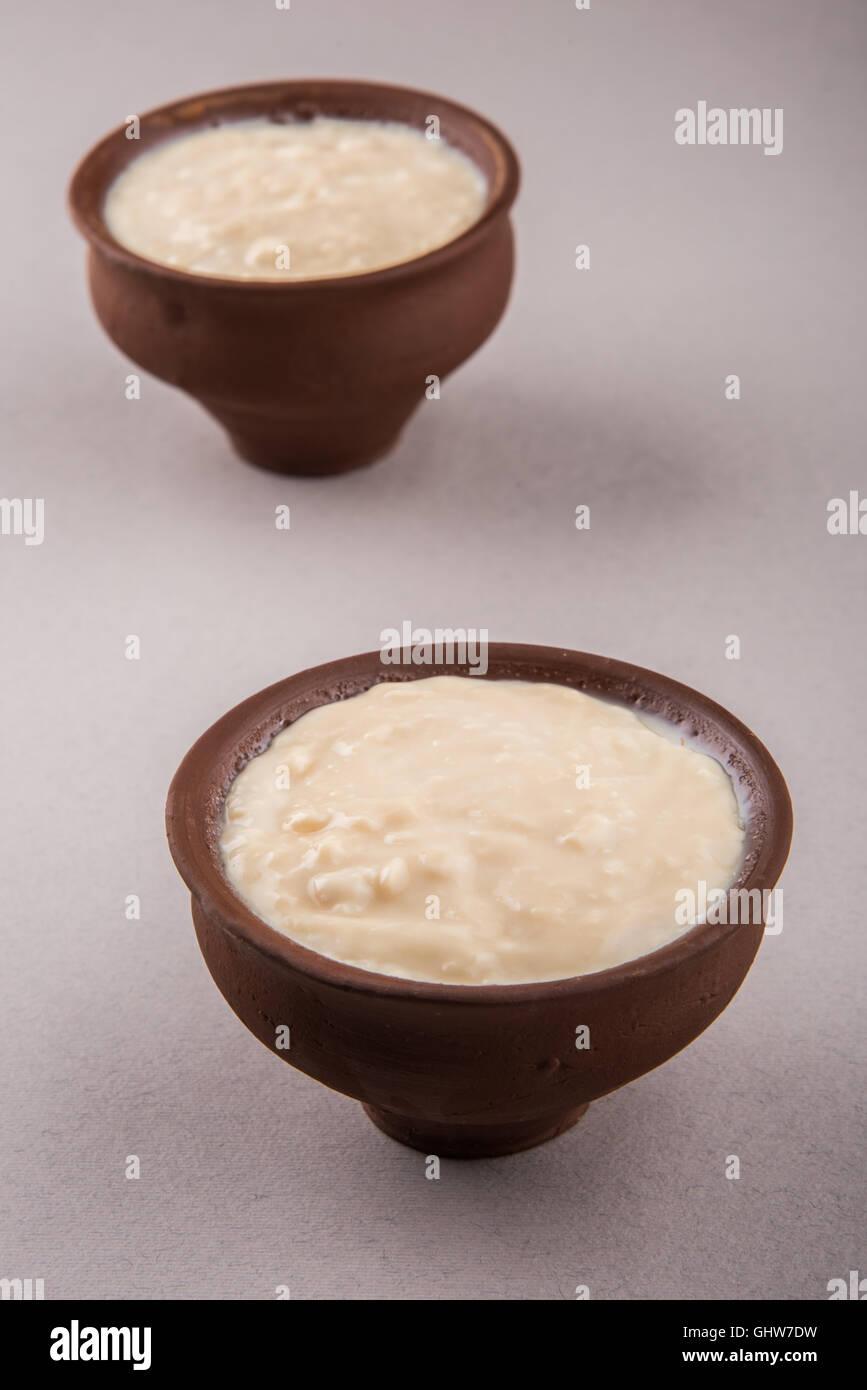 Mishti Doi or Mishti Dahi or Mitha Dahi translate as sweet dahi or sweet yogurt. - Stock Image