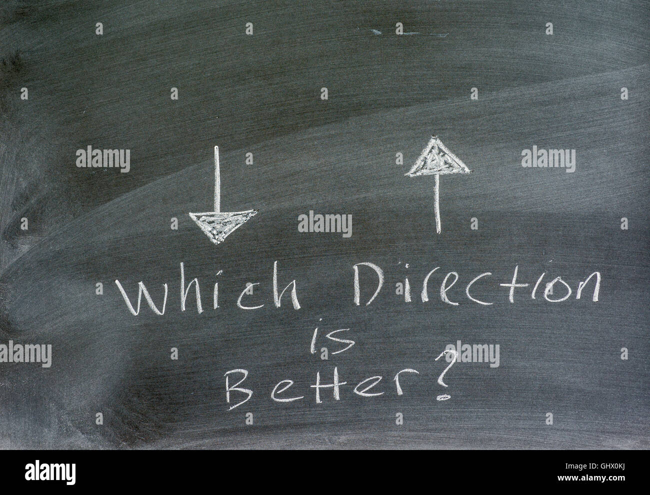 directional arrows written on a chalkboard, conceptual, question. - Stock Image