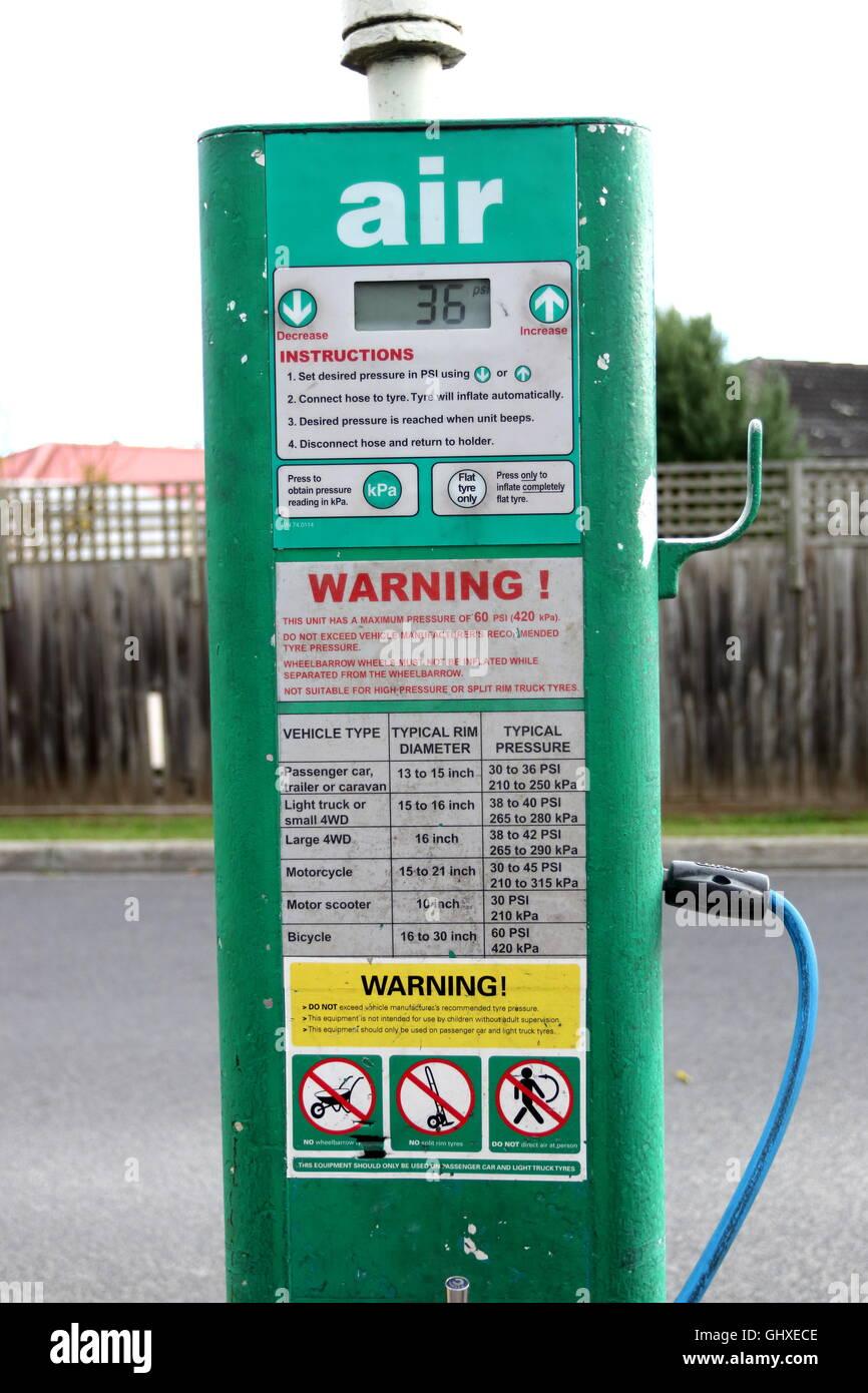 Air Pressure pump hose at BP Petrol Station in Melbourne Victoria Australia - Stock Image