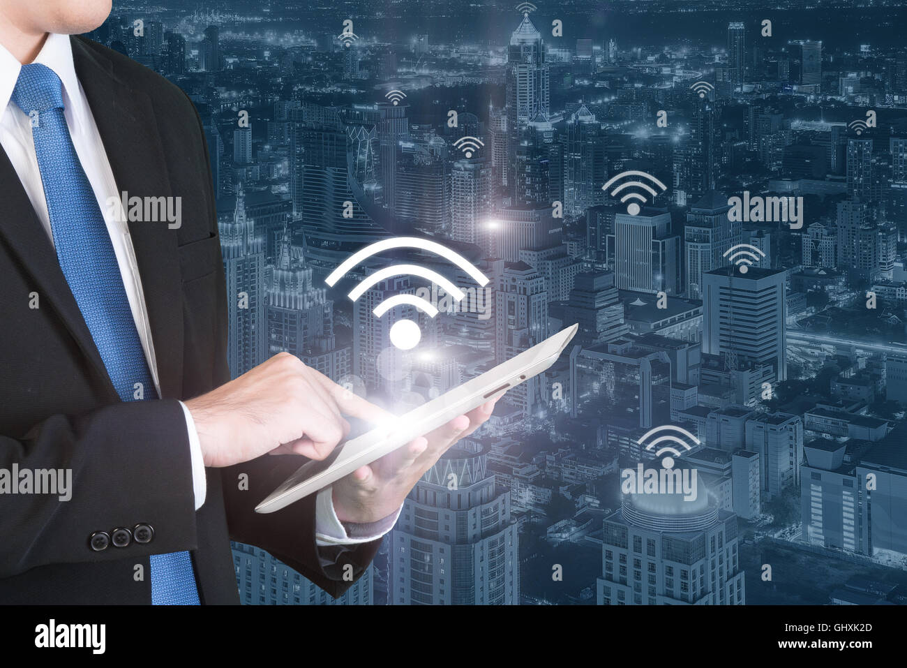 Business technology concept - Business man press digital tablet to connecting wifi or internet in business center - Stock Image