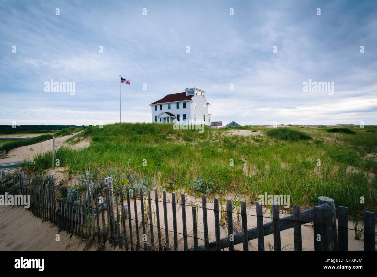 Fence and house at  Race Point, in the Province Lands at Cape Cod National Seashore, Massachusetts. - Stock Image