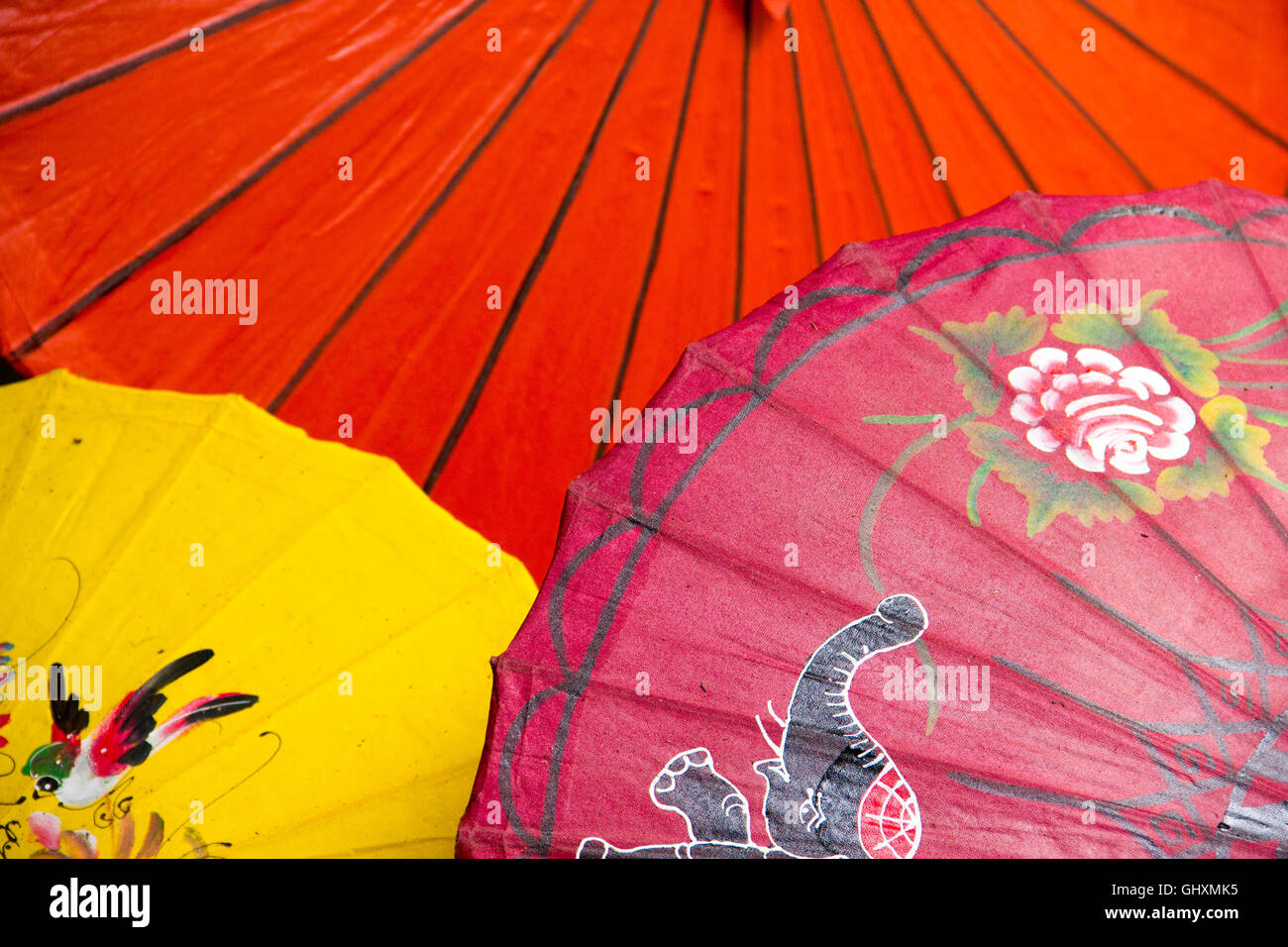 Colorful hand-crafted silk umbrellas at a market in Chiang Mai, Thailand - Stock Image