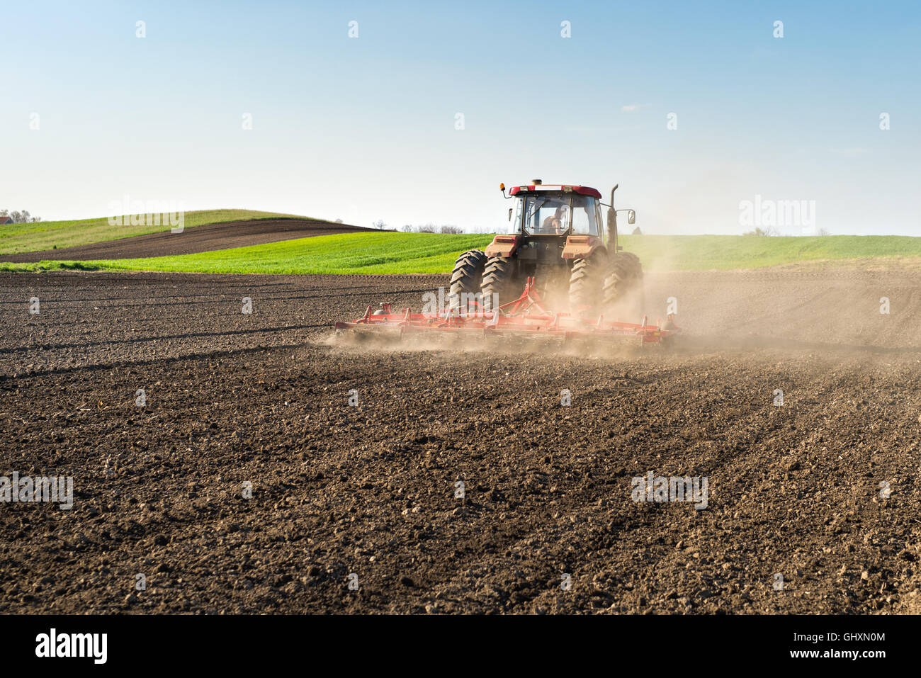 Tractor preparing land for sowing - Stock Image