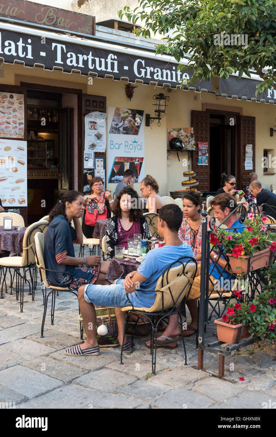People at an outdoor café in old Tropea, Calabria, Italy Stock Photo