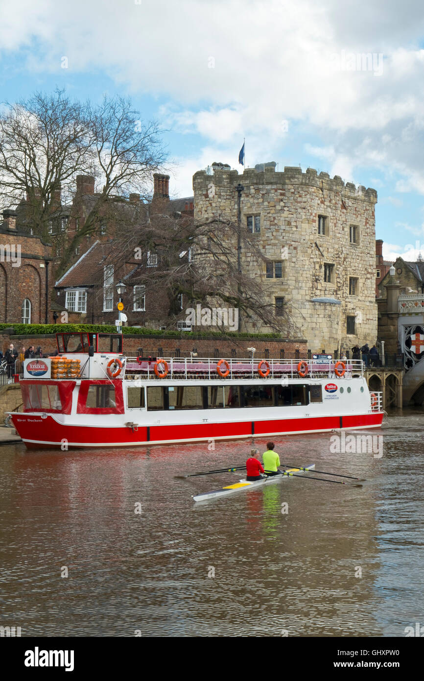 Trip boat sightseeing near Lendal Tower in spring sunshine on the River Ouse, City of York, Yorkshire, UK - Stock Image
