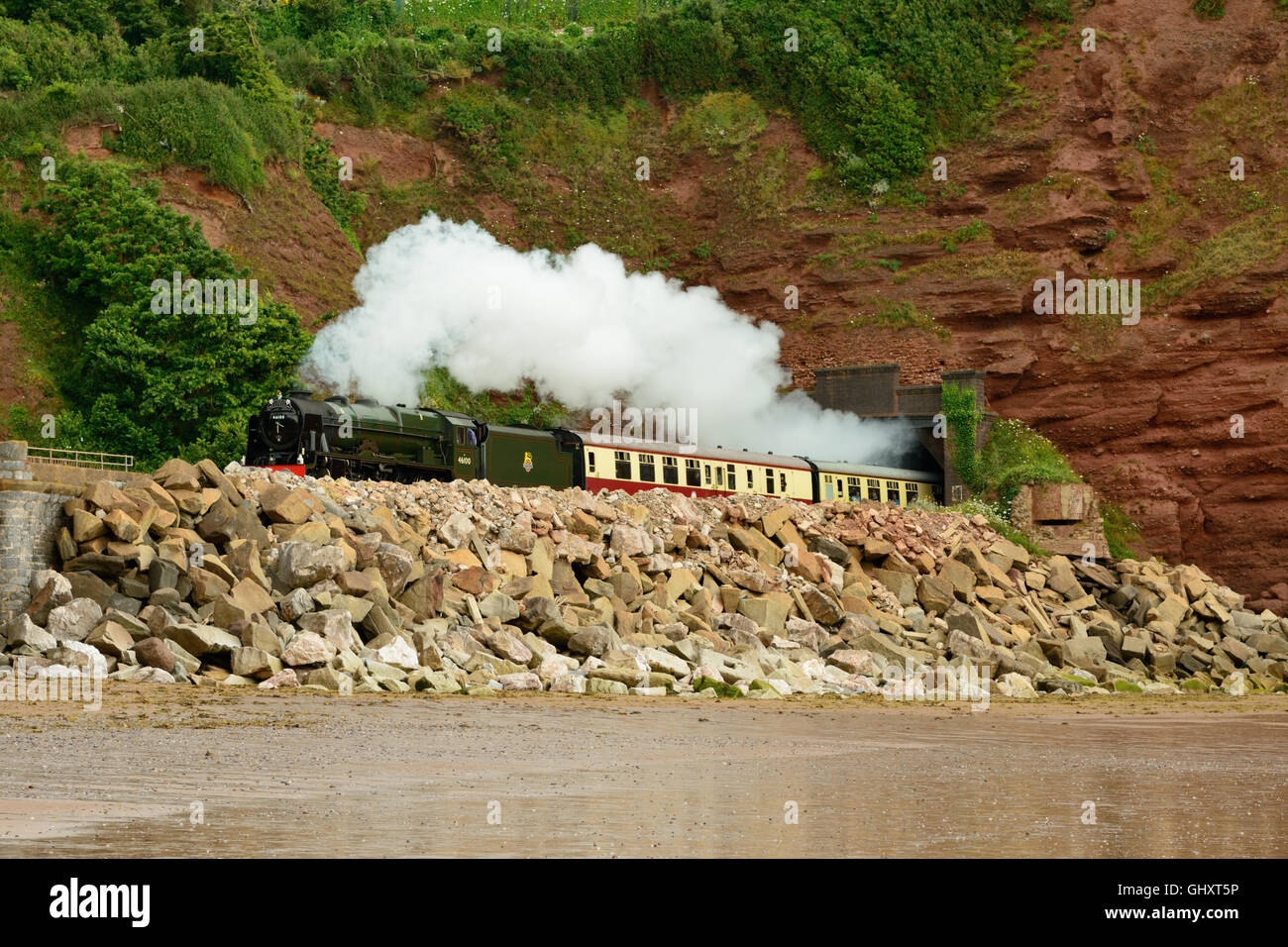 The Torbay Express emerging from Parsons tunnel, hauled by ex-LMS locomotive No 46100 Royal Scot. - Stock Image
