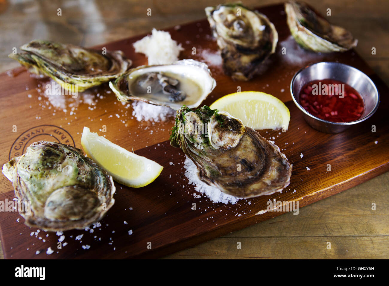 A board of Price Edward Island oysters served at St John's in Newfoundland and Labrador, Canada. Stock Photo