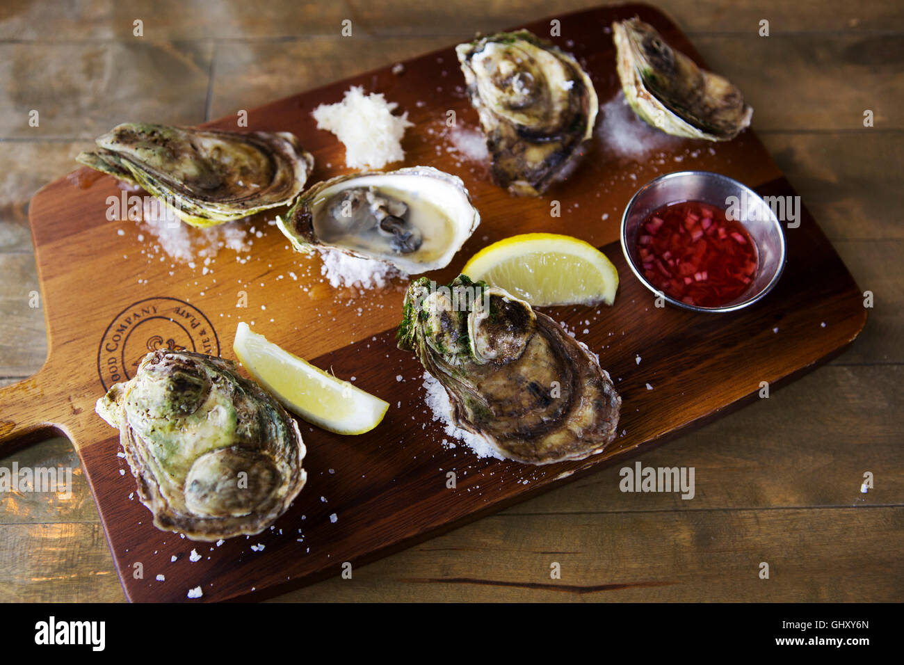 A board of Price Edward Island oysters served at St John's in Newfoundland and Labrador, Canada. - Stock Image