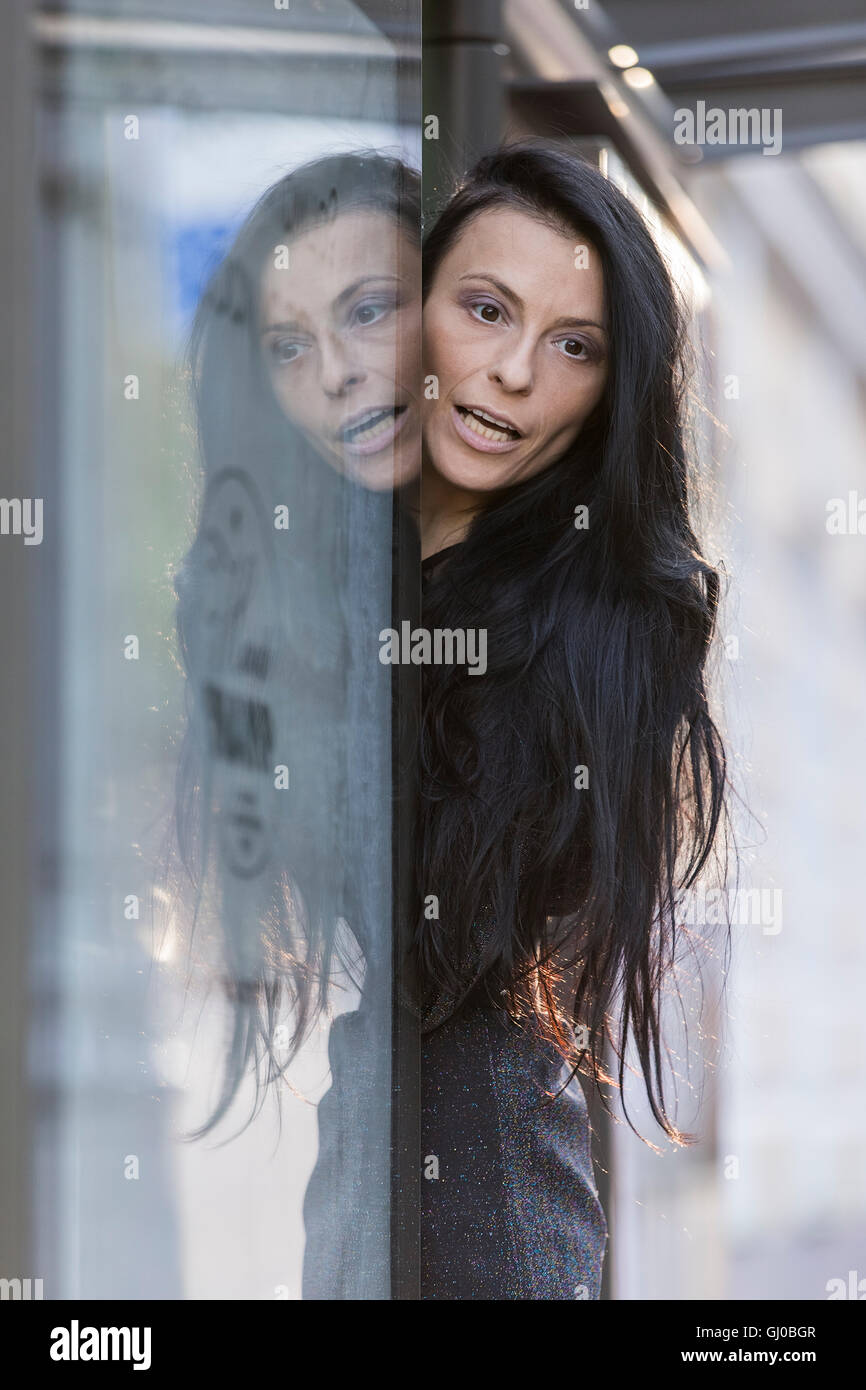 Portrait of a dark-haired woman. - Stock Image