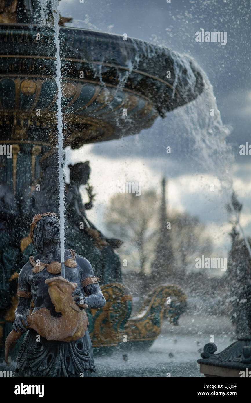 the fountains in the Place de la Concorde with the Eiffel tower beyond, Paris, France - Stock Image