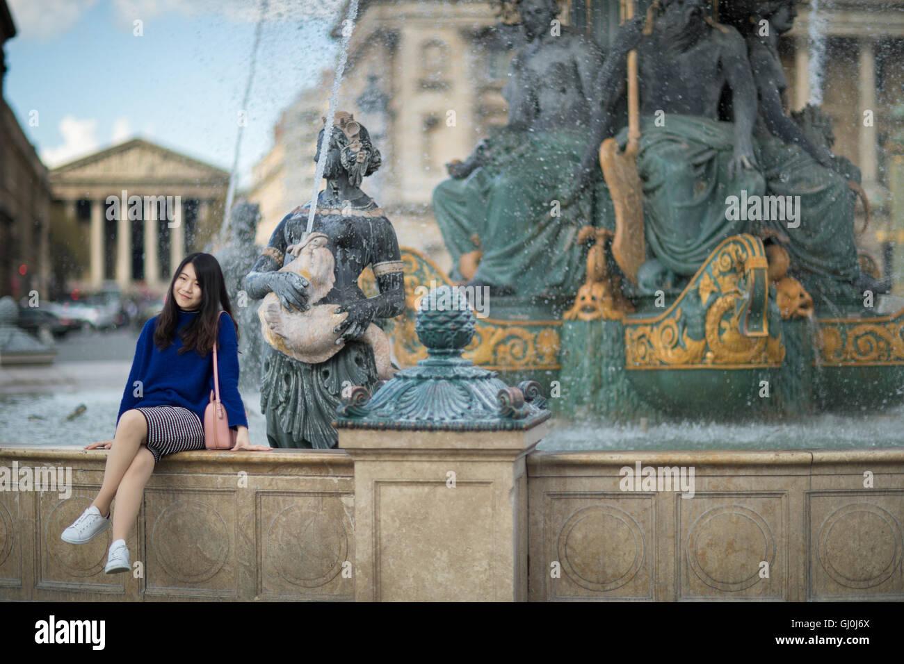 a tourist posing for a photograph in the Place de la Concorde, Paris, France Stock Photo