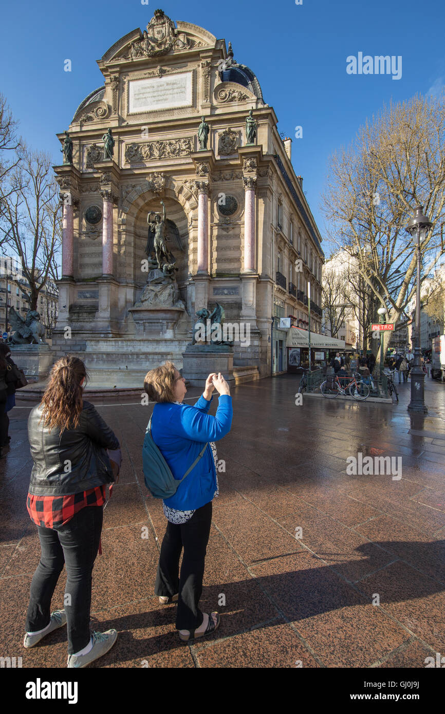 tourists taking photos, Place Saint-Michel, Paris, France - Stock Image