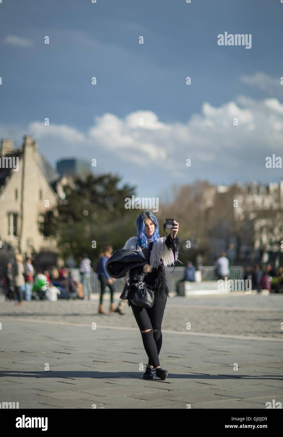 a tourist taking selfies in front of Cathedrale Notre Dame, Île de la Cité, Paris, France - Stock Image