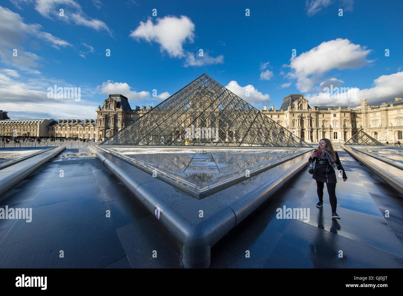 a woman at the Pyramide du Louvre, Paris, France - Stock Image
