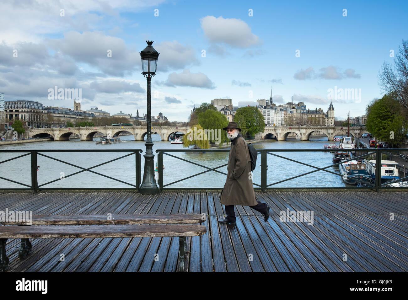 a man on the Pont des Arts, Paris, France - Stock Image