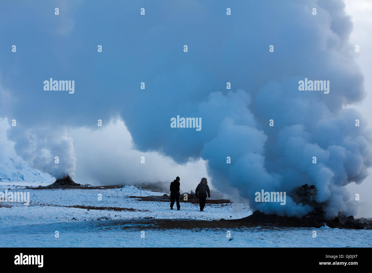 Figures emerging from the geysers at Hverarönd, near Myvatn, north eastern Iceland - Stock Image