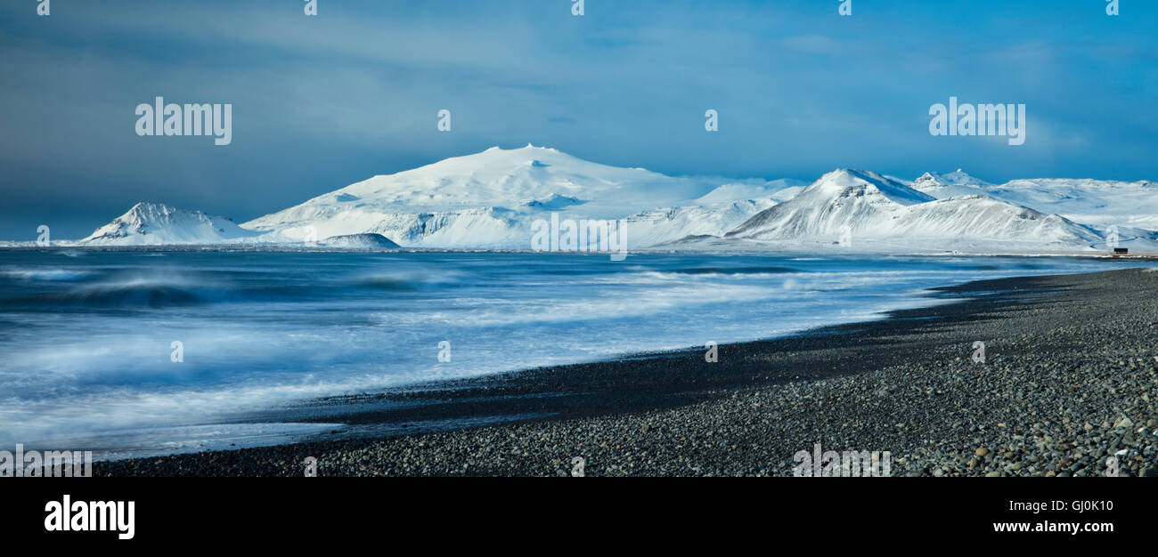 waves breaking at Budavik beneath the Snaefellsjokull, Iceland - Stock Image
