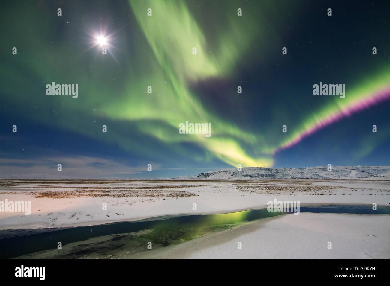 the Northern Lights (Aurora Borealis) over Hornafjörður, eastern Iceland - Stock Image
