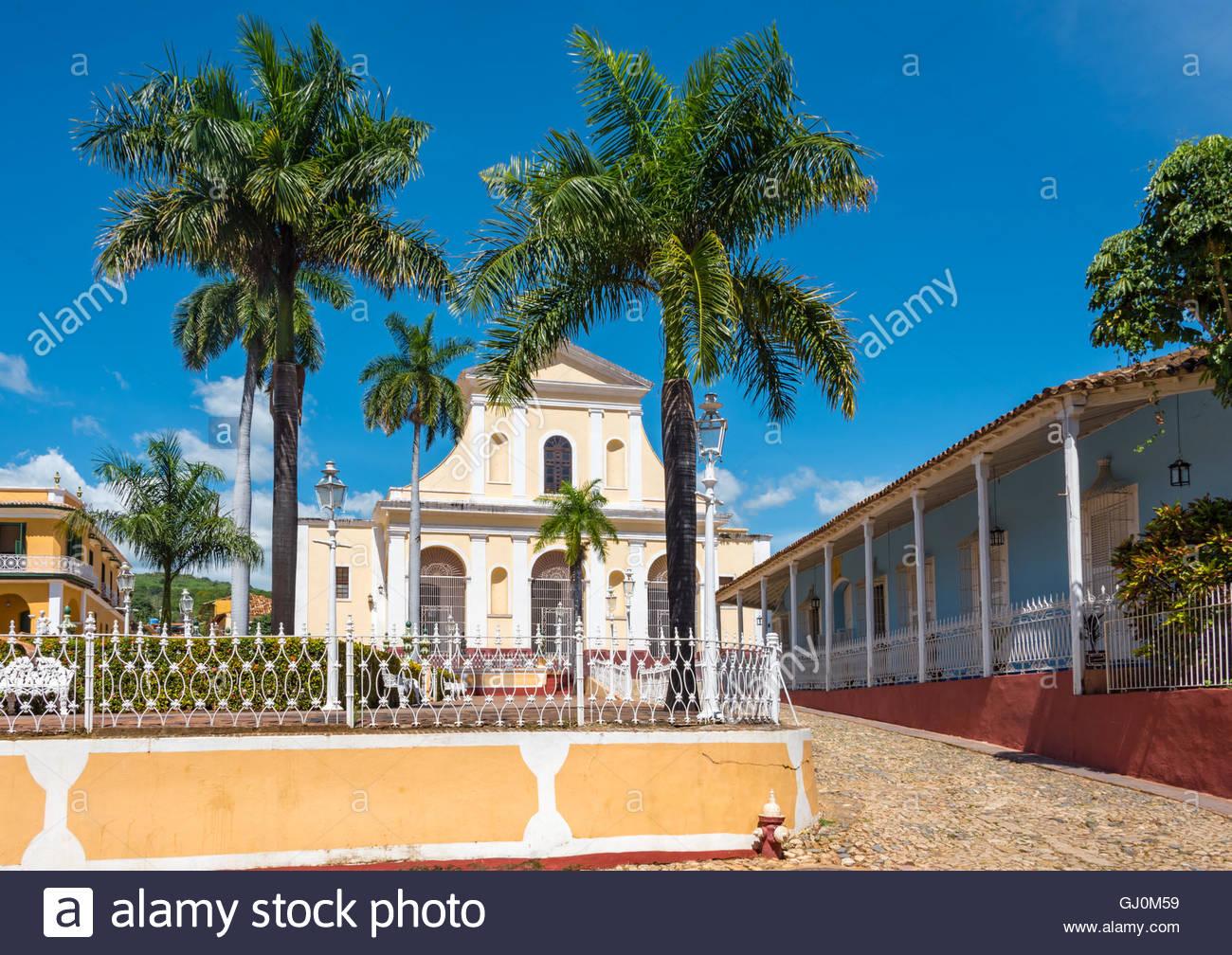 Holy Trinity Church or Iglesia Parroquial de la Santisima Trinidad in the Plaza Mayor of Trinidad de Cuba. The city - Stock Image