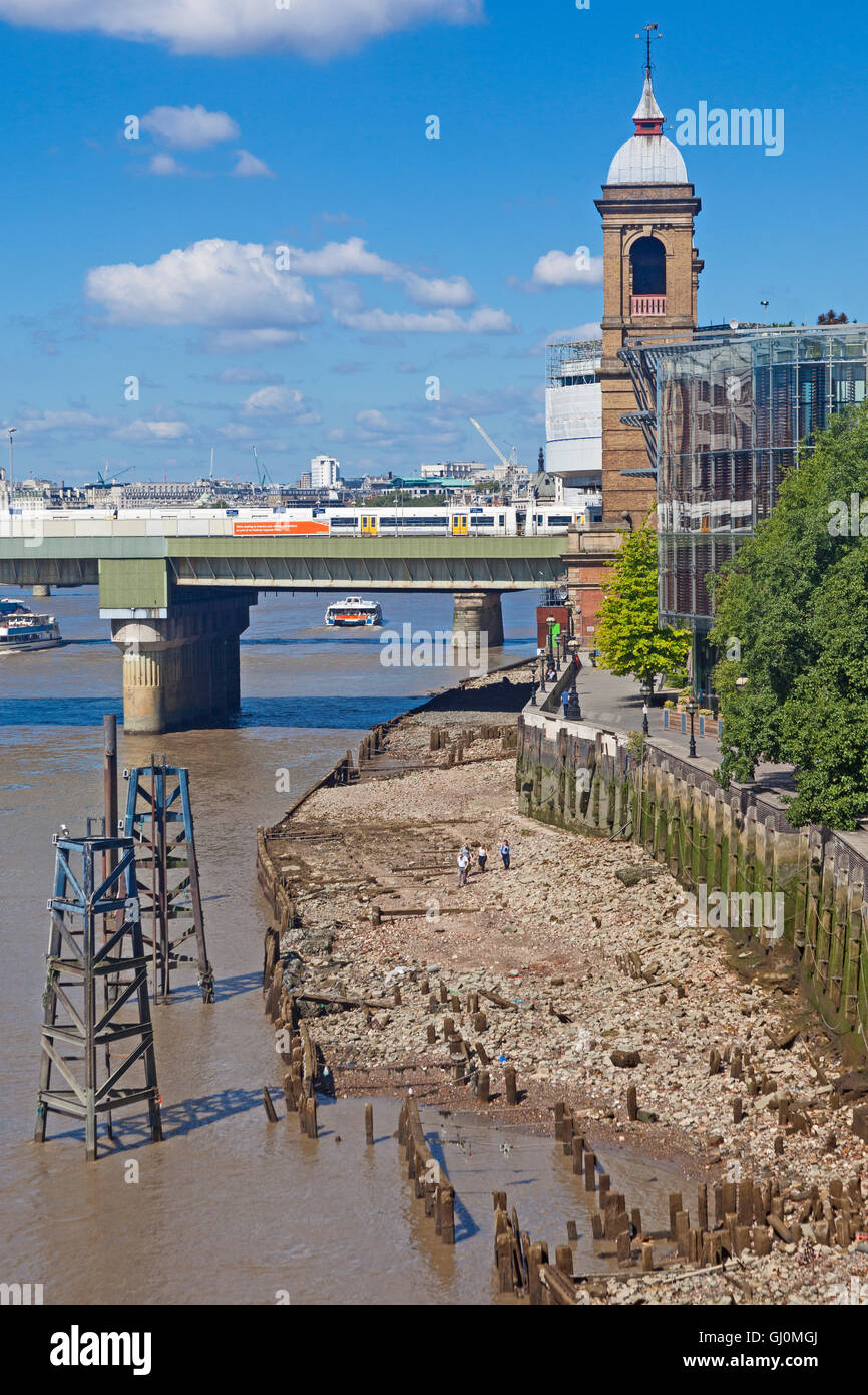 Low tide on the Thames below Cannon Street station, seen from London Bridge - Stock Image