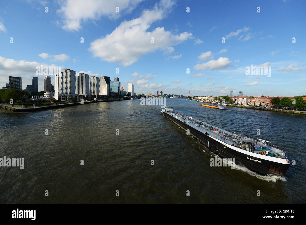 A cargo ship on the Nieuwe Maas river in Rotterdam. Stock Photo