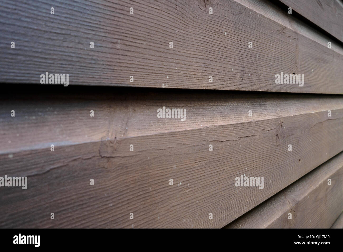 Angled view of wooden panelled wall - Stock Image