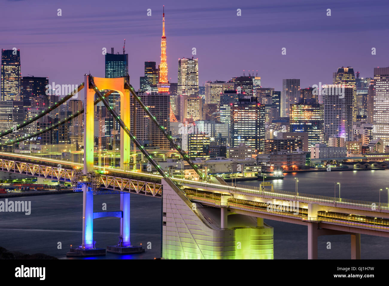 Tokyo, Japan cityscape at Rainbow Bridge and Tokyo Tower. - Stock Image