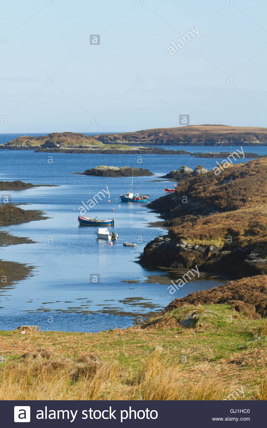 Small boats moored at Eilean na Cille on the east coast of the Isle of Benbecula, Outer Hebrides, Scotland. Stock Photo