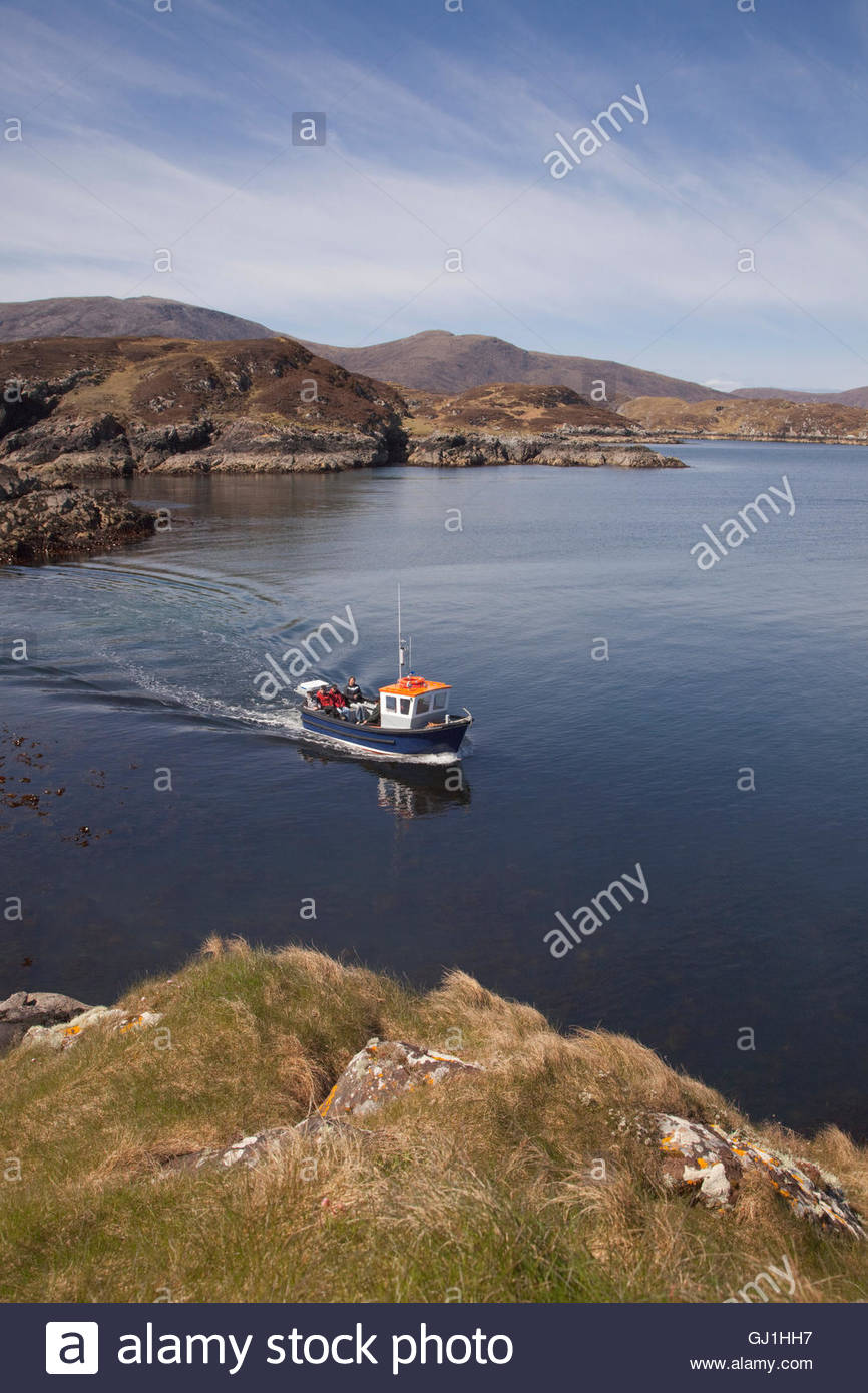 A wildlife watching and fishing boat trip off the coast of the Isle of Harris, Outer Hebrides, Scotland. Stock Photo