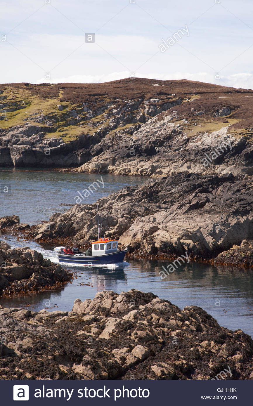 A wildlife watching and fishing boat trip off the coast of the Isle of Harris, Outer Hebrides, Scotland. - Stock Image