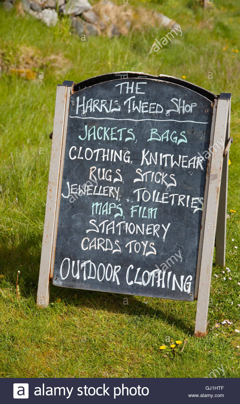 The chalkboard sign for the Harris Tweed shop, Isle of Harris, Outer Hebrides, Scotland. - Stock Image
