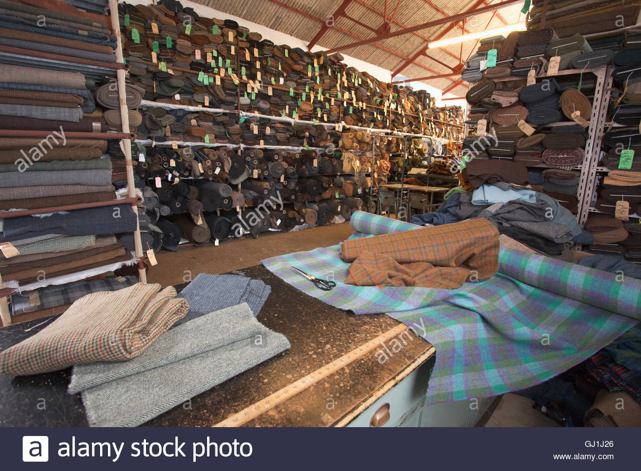 Part of the huge stock of woven Harris Tweed cloth at the Harris Tweed and Knitwear Shop, Tarbert, Isle of Harris, - Stock Image
