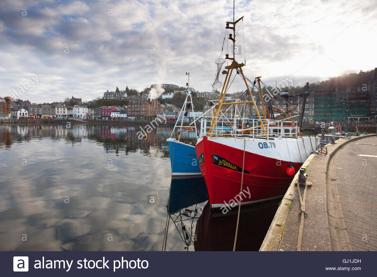The view across the bay towards McCaig's Tower, Oban, Argyll, Scotland. - Stock Image