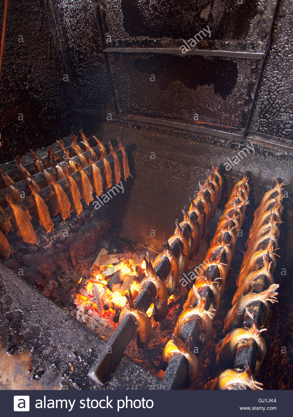 Producing the local delicacy, The Arbroath Smokie - a North Sea Haddock hot smoked over hardwood chips at M&M - Stock Image