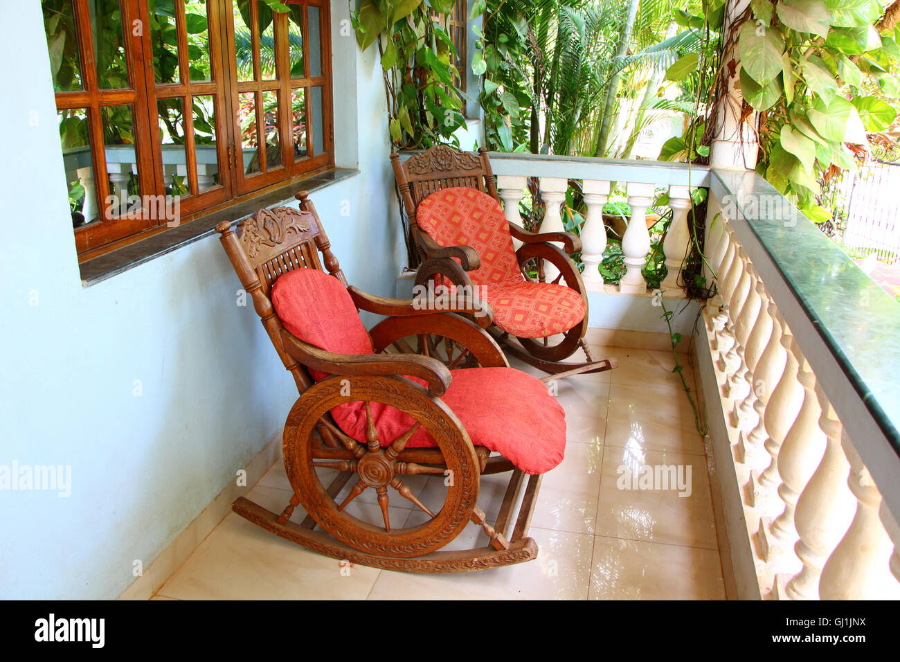 rocking chairs on the veranda, south india, palm resort, veranda chair, terrace chairs, terrace in hotel, marble - Stock Image