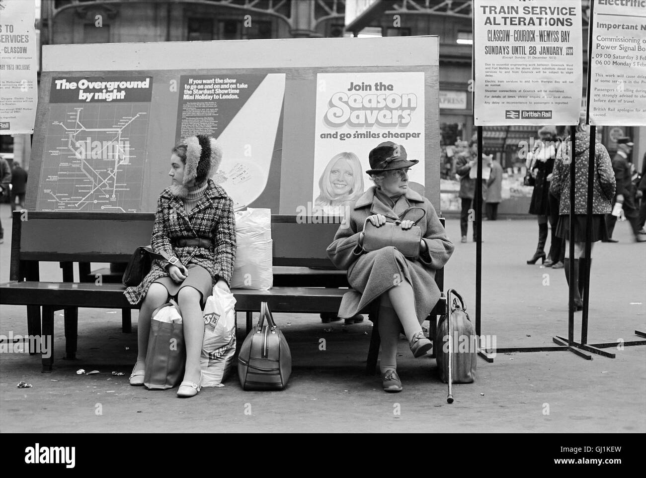 Waiting for the train in Central Station Glasgow, 1972 approx - Stock Image