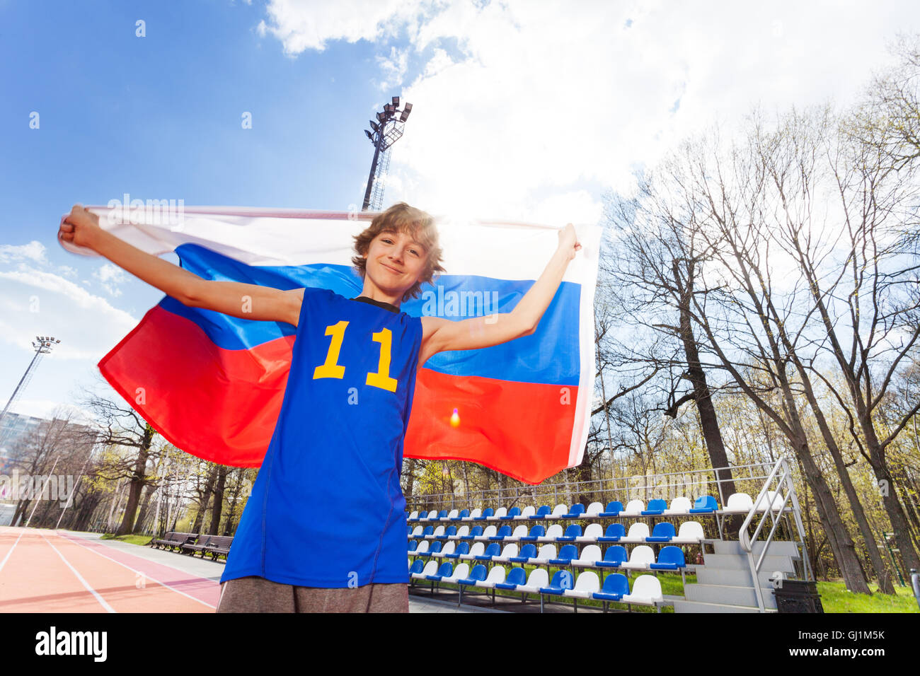 sporty teenage boy waving russian flag at stadium stock photosporty teenage boy waving russian flag at stadium