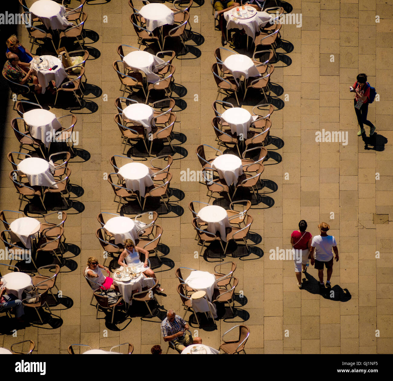Aerial View Of St Marks Square With People Sitting At The Venice Italy
