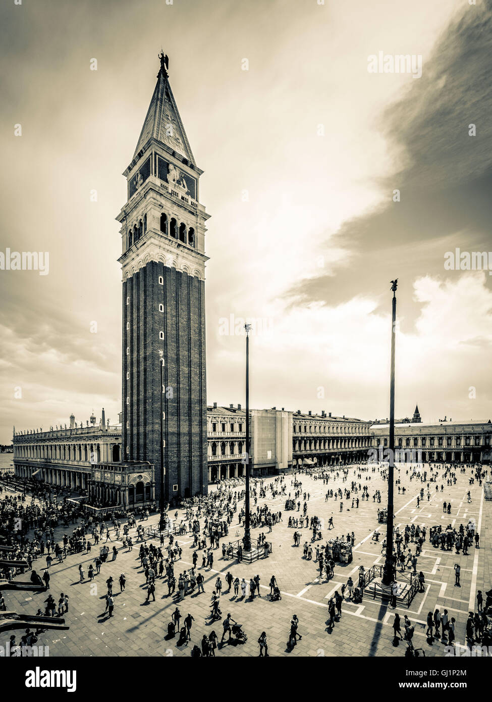 View from the loggia or balacony of St Mark's Basilica, of the tourist packed square below and nearby bell tower. - Stock Image