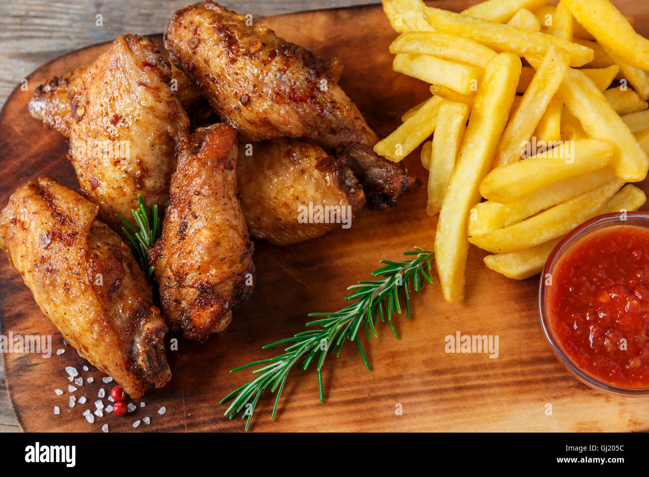 fried chicken wings french fries and sauce Stock Photo