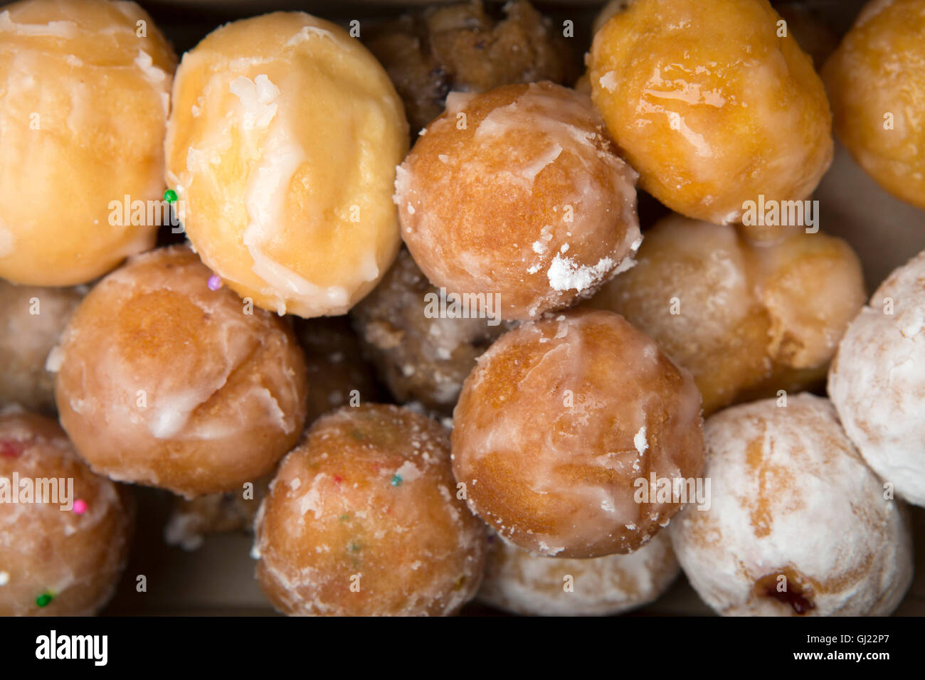 A box of Timbits served in Canada. The glazed, bite-sized pieces of doughnut are served at Tim Horton's stores. Stock Photo