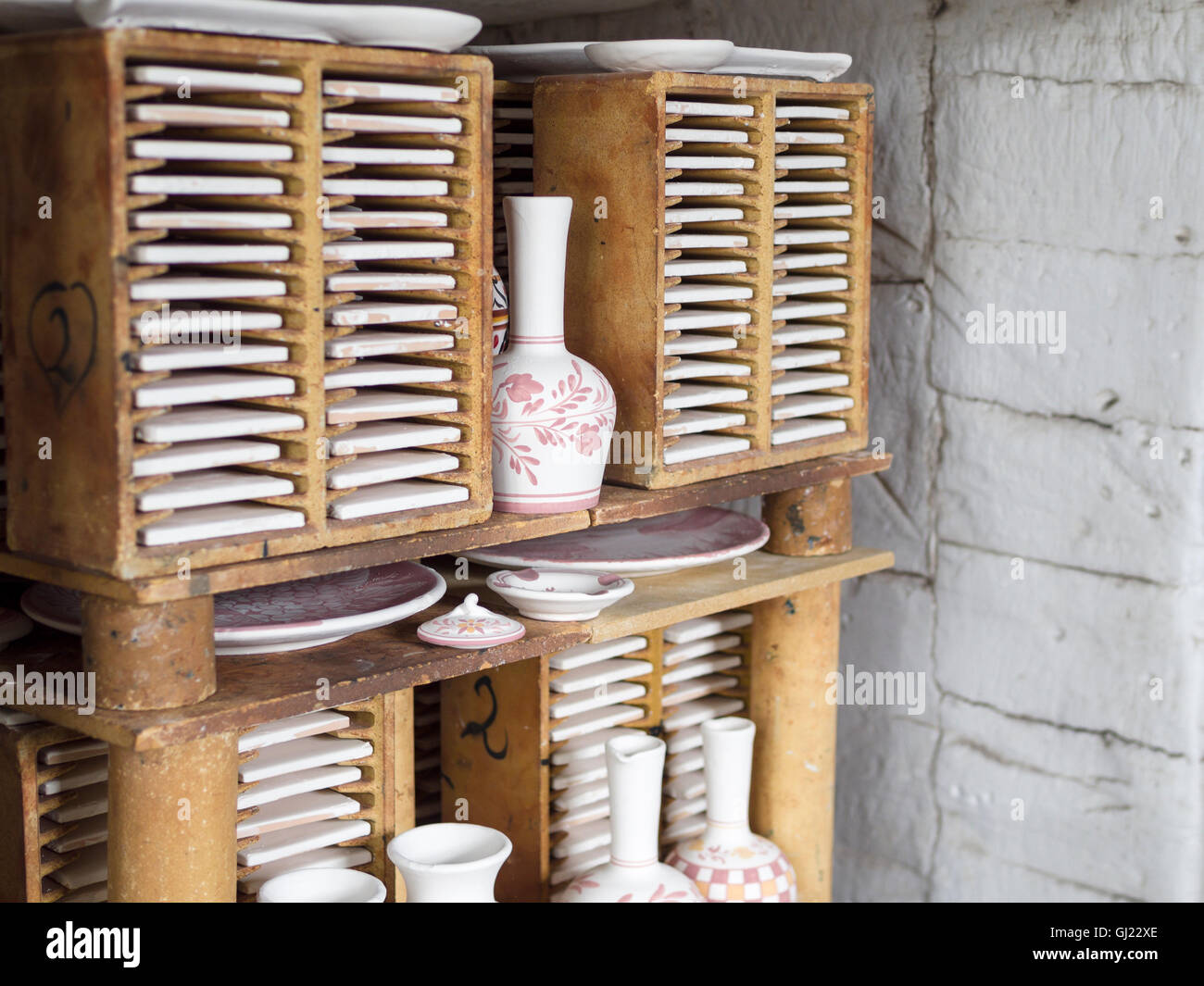 Ceramics Ready for Firing. Detail of a batch of pottery stacked inside a large furnace ready to be glazed at Ceramic - Stock Image