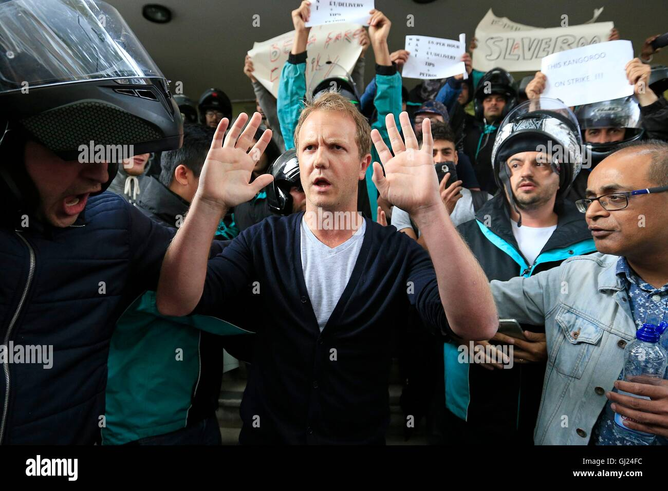 Deliveroo riders hold a protest outside the company HQ in Torrington Place, London. - Stock Image