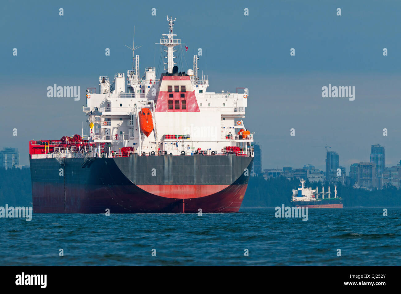 Two empty cargo ships anchored just outside Vancouver, British Columbia, Canada. - Stock Image
