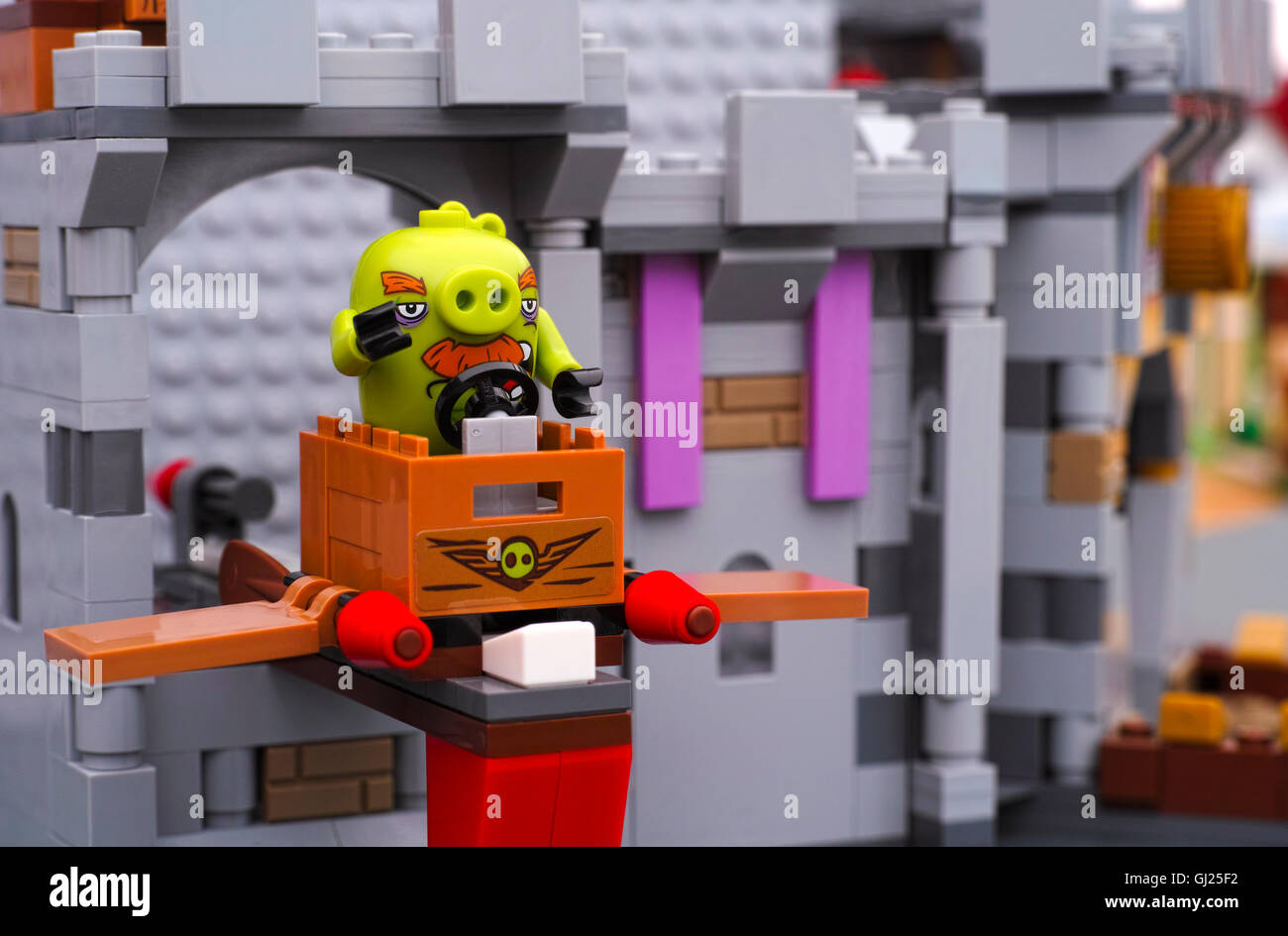 Tambov, Russian Federation - July 20, 2016 Lego Angry Birds. Foreman Pig sitting in TNT box with wings at King Pigs - Stock Image