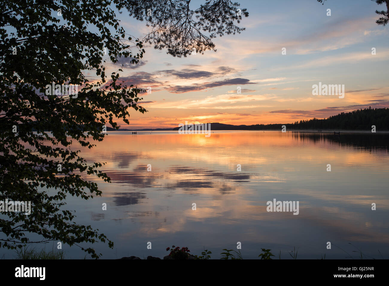 Calm lake at sunset - Stock Image