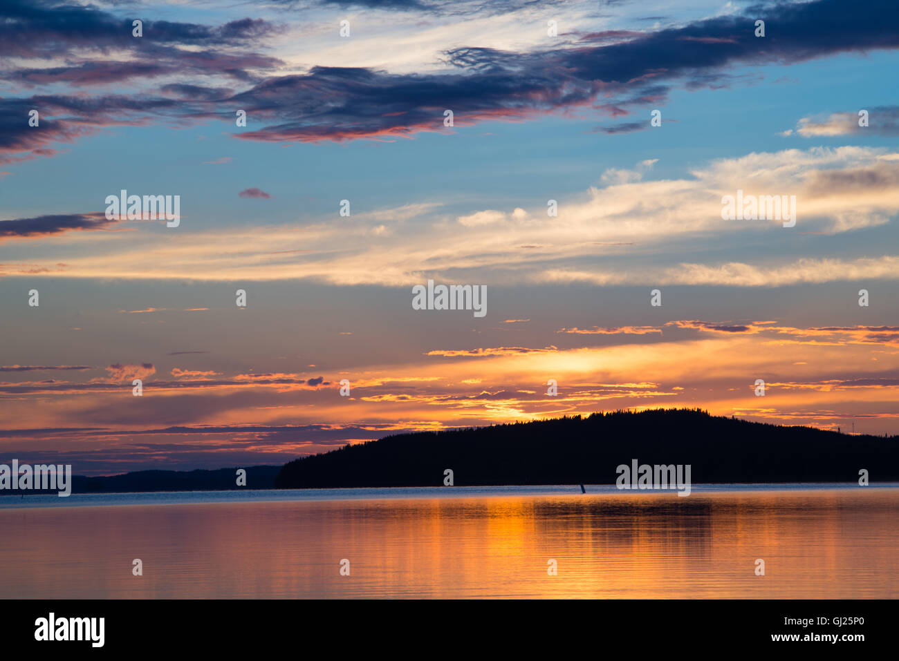 Colorful clouds at sunset - Stock Image
